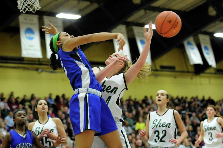 Shaker's Madison Rowland (12), left, blocks a shot by Shenedehowa's Ashley Acker (24) during their basketball game on Thursday, Jan. 10, 2013, at Siena College in Loudenville, N.Y. (Cindy Schultz / Times Union) Photo: Cindy  Schultz / 00020711A