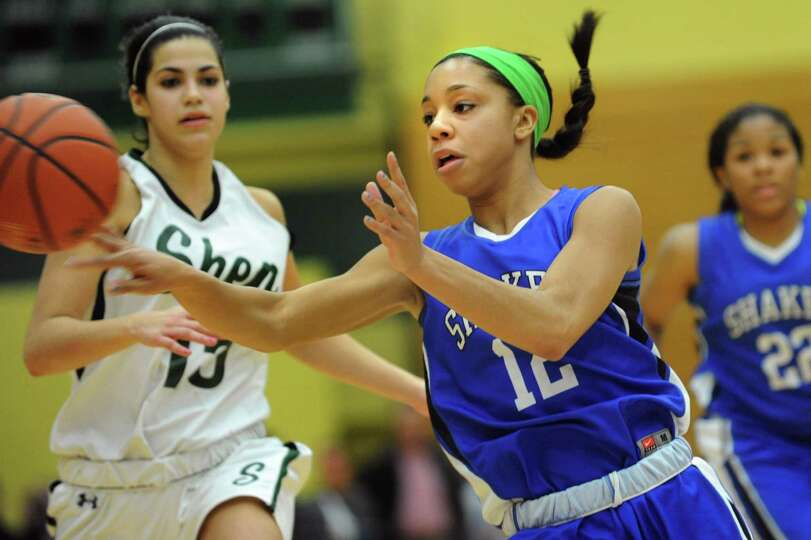 Shaker's Madison Rowland (12), center, passes the ball during their basketball game against Shenende