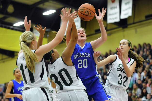 Shaker's Sage VanAmerongen (20), center, fights off Shenendehowa's defense for a rebound during their basketball game on Thursday, Jan. 10, 2013, at Siena College in Loudonville, N.Y. (Cindy Schultz / Times Union) Photo: Cindy Schultz / 00020711A
