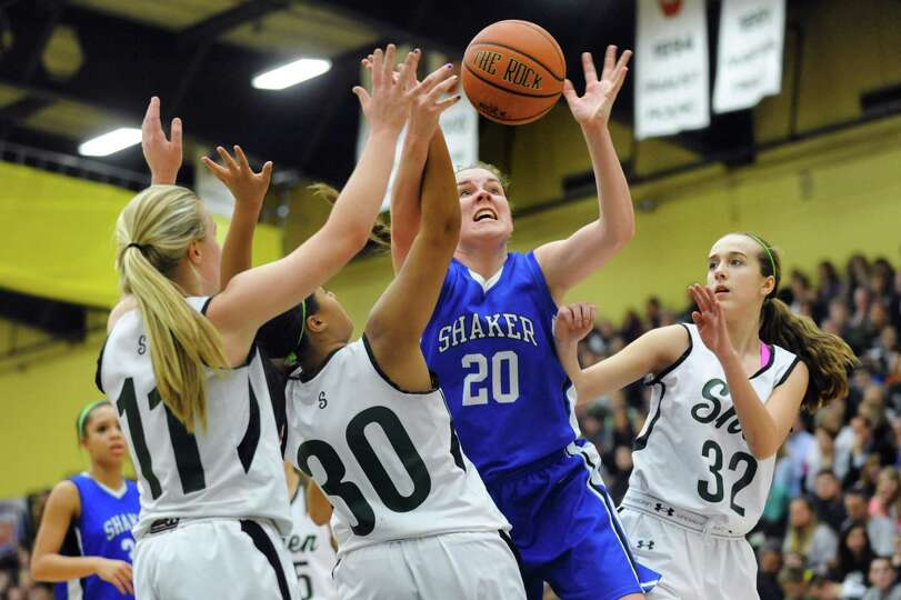 Shaker's Sage VanAmerongen (20), center, fights off Shenendehowa's defense for a rebound during thei