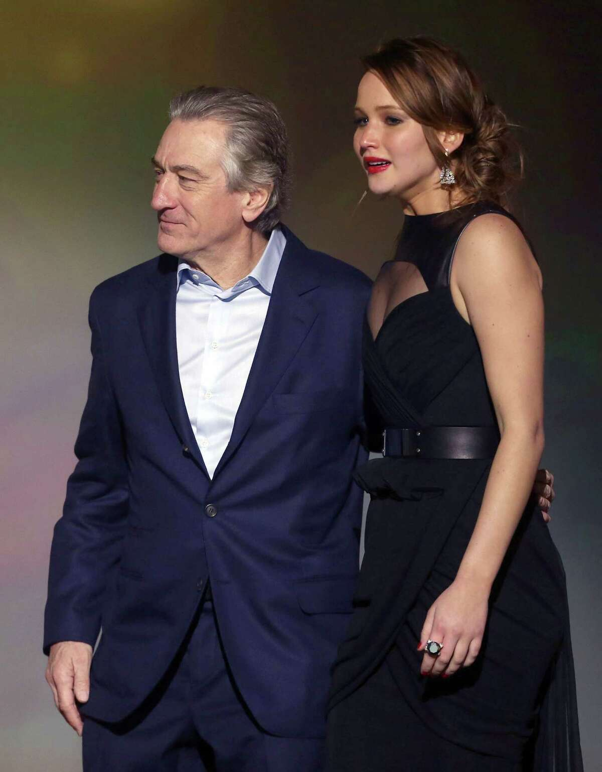 Robert De Niro, left, and Jennifer Lawrence are seen on stage.