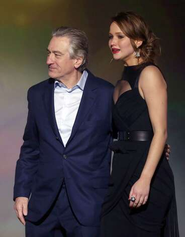 Robert De Niro, left, and Jennifer Lawrence are seen on stage. Photo: Matt Sayles/Invision/AP