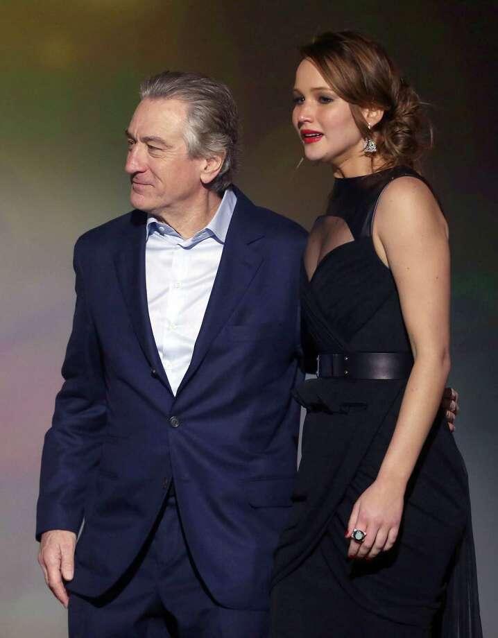 Robert De Niro, left, and Jennifer Lawrence are seen on stage. Photo: Matt Sayles/Invision/AP