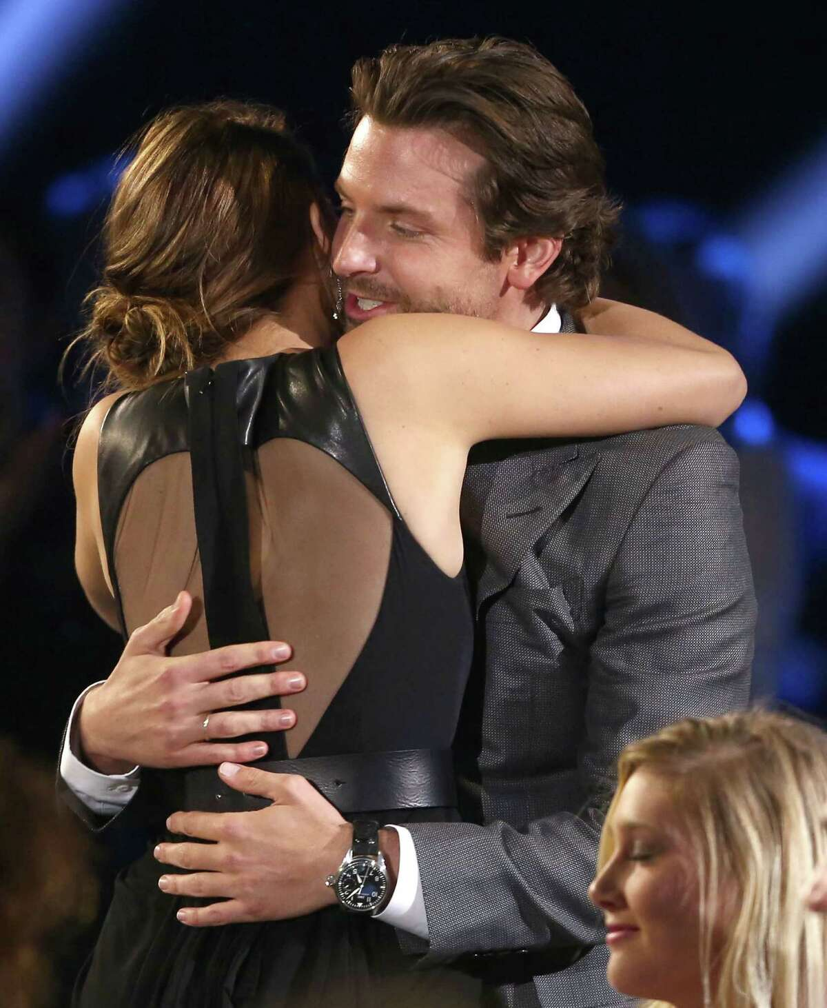 Bradley Cooper, right, and Jennifer Lawrence are seen.
