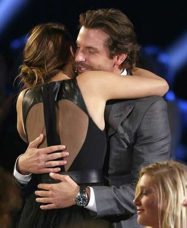 Bradley Cooper, right, and Jennifer Lawrence are seen. Photo: Matt Sayles/Invision/AP
