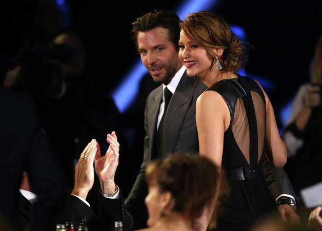 Bradley Cooper, left, and Jennifer Lawrence are seen at the 18th Annual Critics' Choice Movie Awards at the Barker Hangar  in Santa Monica, Calif., on Thursday, Jan. 10, 2013. Photo: Matt Sayles/Invision/AP
