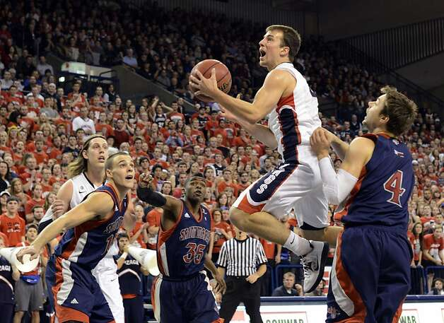 Kevin Pangos parts St. Mary's defenders Beau Levesque, James Walker III and Matthew Dellavedova in the first half as he pursues some of his 22 points. Photo: Jed Conklin, Associated Press