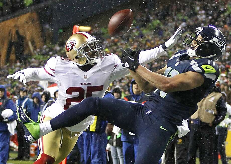 Tarell Brown breaks up a pass intended for Seahawks receiver Jermaine Kearse. Photo: John Froschauer, Associated Press