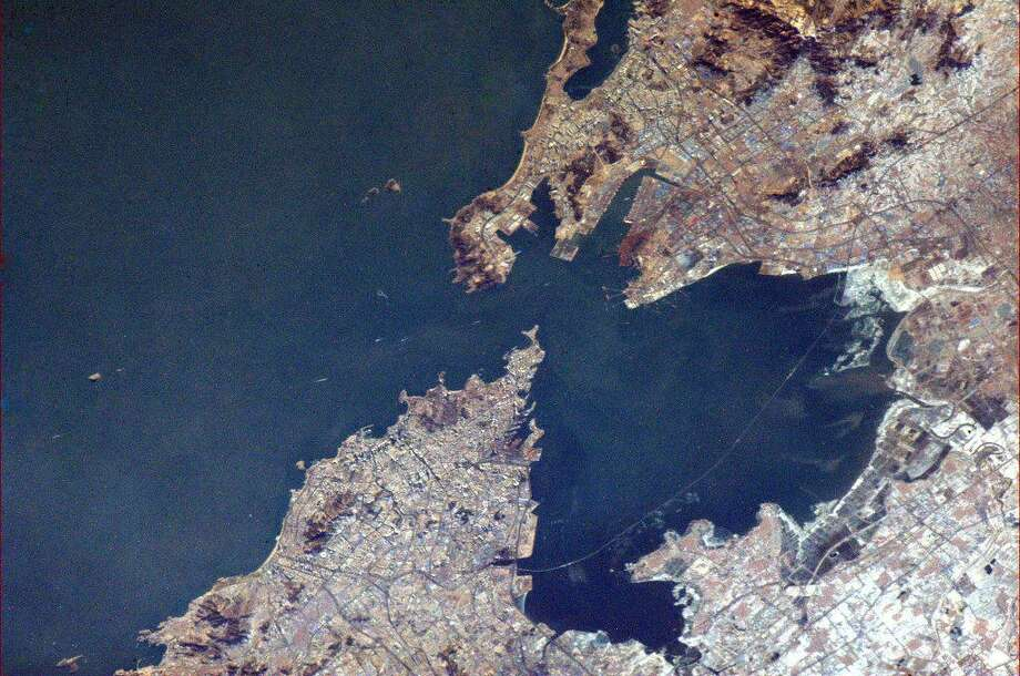 Hadfield says this photo is of Qingdao, or Tsingtao, in China. The city has the world's longest sea bridge, which can be seen as a thin line in the photo.