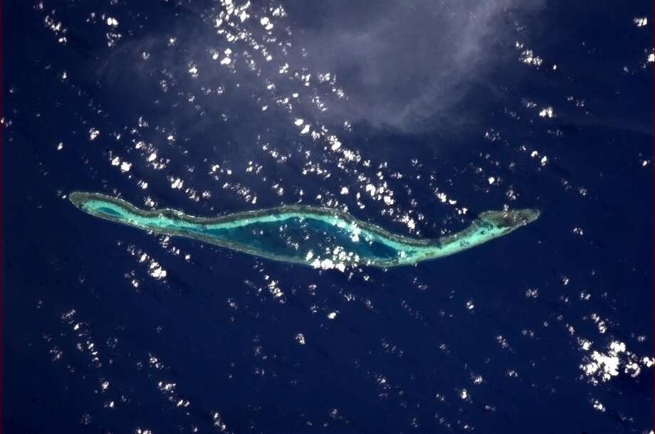 Hadfield says: An island made for running laps. Off the coast of Indonesia.