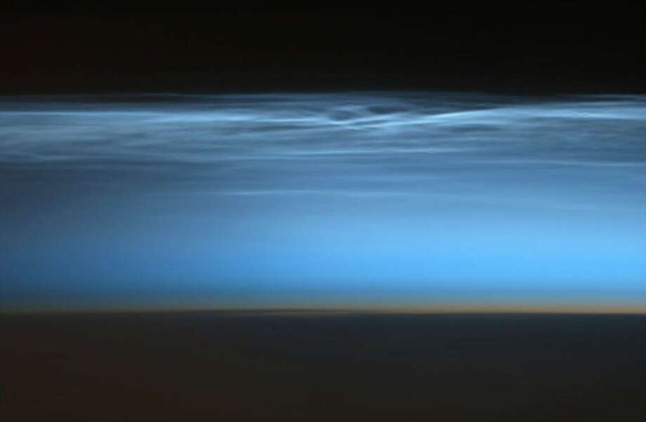 A Noctilucent Cloud, a rare super high altitude cloud barely visible from Earth, is seen at dawn in the mesosphere from International Space Station. Photo: Cmd. Chris Hadfield, Associated Press / The Canadian Press via NASA,Chri