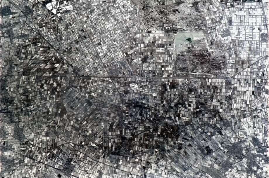 Hadfield says: A crazed stained glass mosaic - the winter black and white of farms in central Asia.