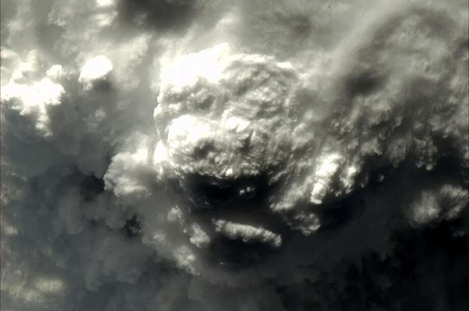 Hadfield says this photo is a thunderstorm and asks followers: What animal do you see?