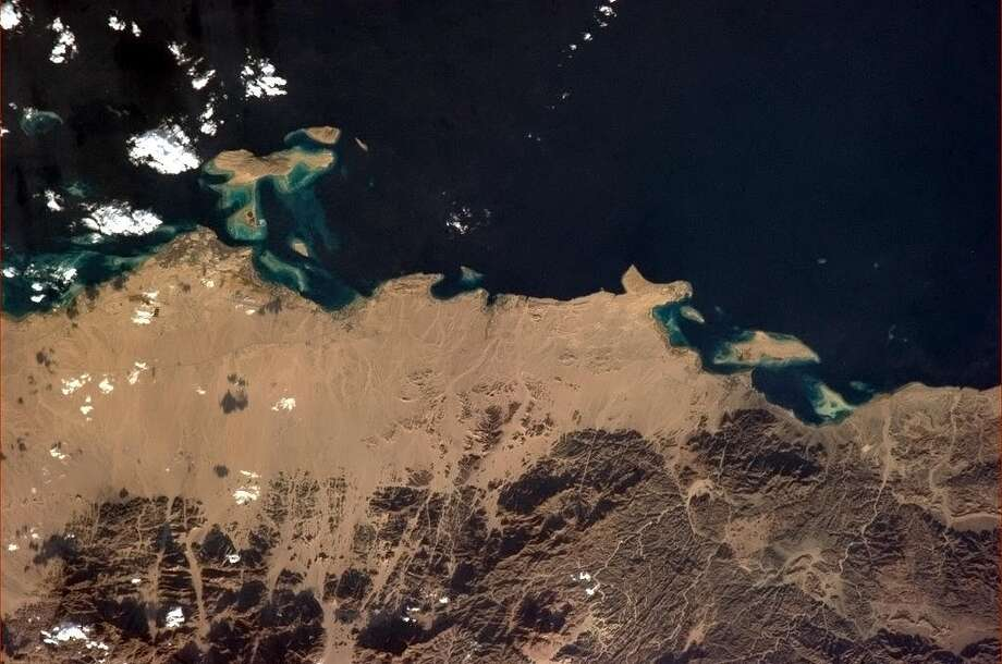 Hadfield Tweets: Hurghada, Egypt, a popular tourism and diving site on the Red Sea.