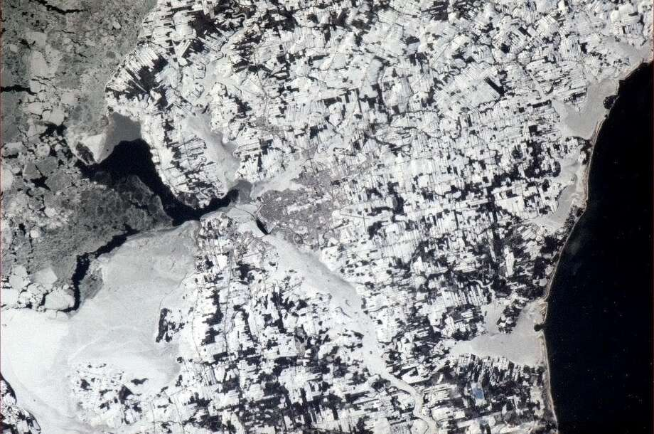 Hadfield Tweets: Charlottetown, PEI. The birthplace of Canada's Confederation, seen from orbit by a Canadian, 146 years later.