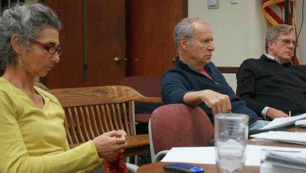 Democratic Planning and Zoning Commission members, Nora Jinishian, Ron Corwin and Howard Lathrop, at Thursday's meeting. Corwin was highly critical of Republican board members for adjourning to a private caucus during discussion of a text amendment.  Westport CT 1/10/13 Photo: Paul Schott / Westport News