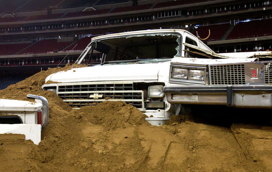 Vehicles are seen covered with dirt along the track. Photo: Cody Duty, Houston Chronicle / © 2012 Houston Chronicle