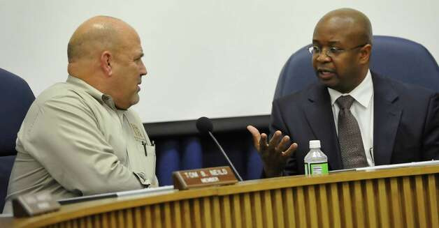 School Board member Tom Neild, left,  listens to BISD Superintendent Timothy Chargois, right, before the start of the meeting.  The Beaumont Independent School Board met Thursday night, January 10, 2013, at 6:30 p.m. in the board room of the administration building to discuss the Department of Justice objection to a 5-2 election scheme and what their future plans would be.  Dave Ryan/The Enterprise Photo: Dave Ryan