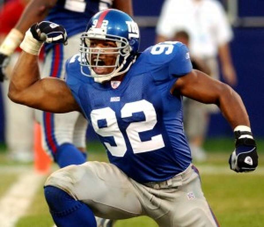 Michael Strahan was a four-time All-Pro during his 15-year career with the New York Giants. (Bill Kostroun/Associated Press)