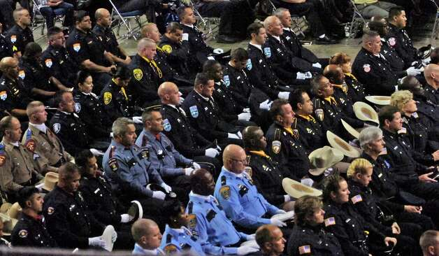 Officers from all over Texas sit in the Beaumont Civic Center for the funeral of Beaumont Police Officer Bryan Mitchell Hebert who was killed in the line of duty on July 8th.  Dave Ryan/The Enterprise Photo: Dave Ryan