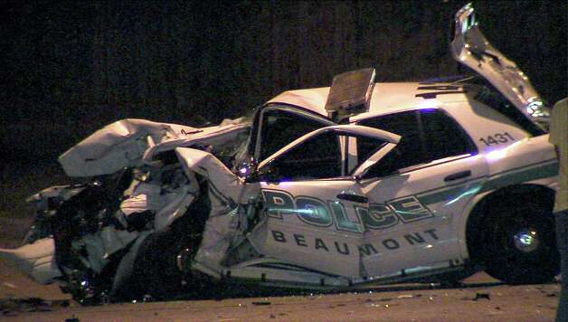 This photo provided by Enterprise media partner 12news.com shows a patrol car that was part of the collision where Beaumont police officer Bryan Hebert was struck by a car involved in a high speed chase with police Friday night. Hebert later died at a hospital. photo provided by 12news.com Photo: Provided