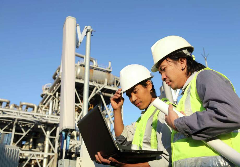 Oil and gas industry projects involve many workers from the planning and start-up phase through construction and close-out. The skills needed to fulfill these projects are varied and come from within companies, from contract workers and from other firms brought in at various stages to provide expertise. / iStockphoto