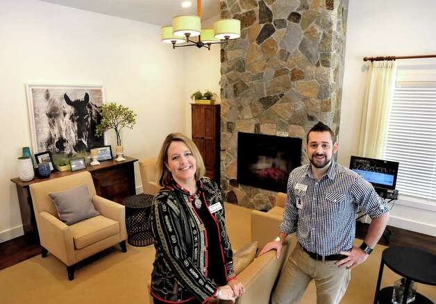 Michelle Bettigole and Seth Machak stand in the great room of The Villa, a memory care home at The Watermark at East Hill, in Southbury Friday, Jan. 11, 2012. Photo: Michael Duffy