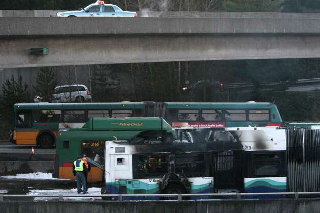 Emergency crews work the scene after a Sound Transit express bus erupted in flames on Friday, January 11, 2013 on the southbound Interstate 5 express lanes. Photo: JOSHUA TRUJILLO / SEATTLEPI.COM