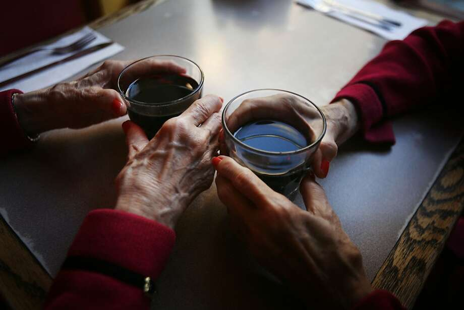 The San Francisco Twins, Marian and Vivian Brown sip merlot during their weekly pizza night at Uncle Vito's on Monday, Sept. 22, 2008 in San Francisco, Calif. Photo: Mike Kepka, The Chronicle