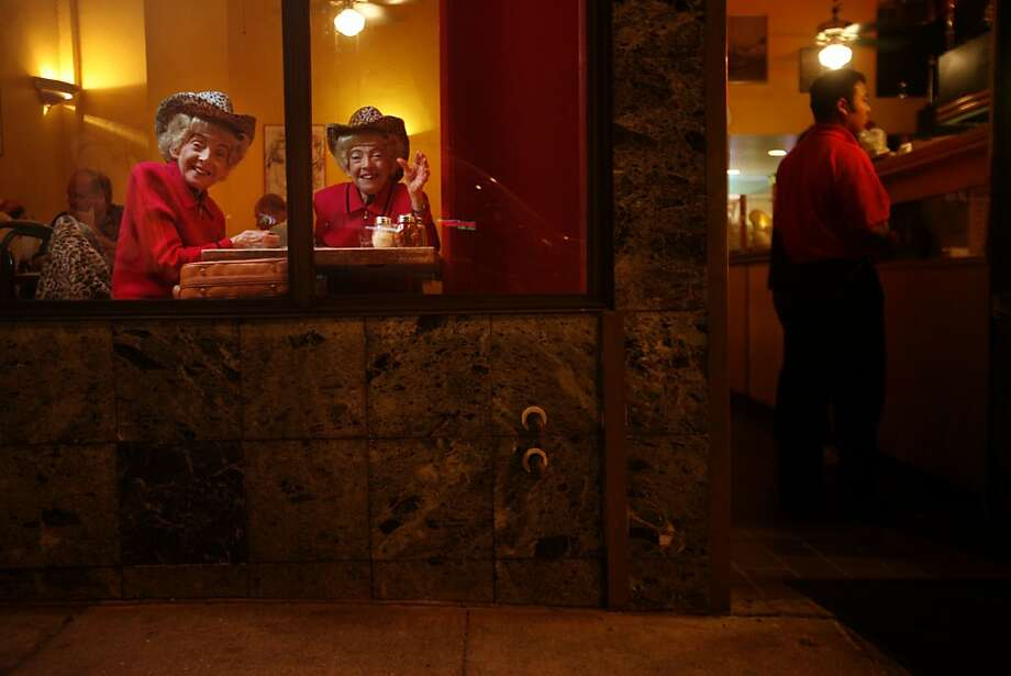 The San Francisco Twins, Marian and Vivian Brown pose for a quick picture during their weekly pizza night at Uncle Vito's on Monday, Sept. 22, 2008 in San Francisco, Calif. Photo: Mike Kepka, The Chronicle