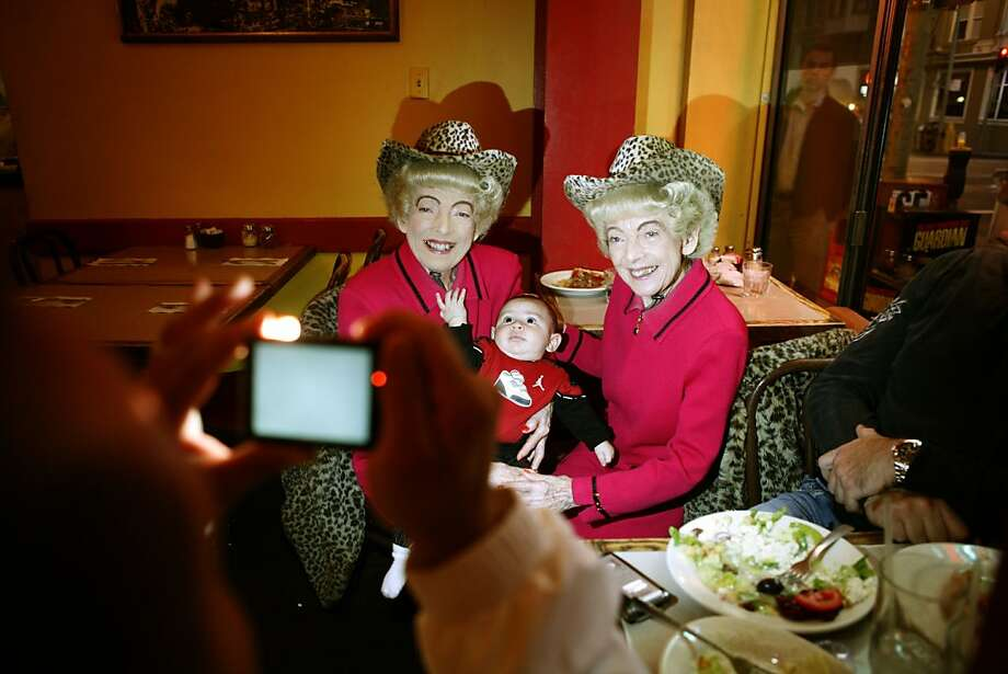 The San Francisco Twins, Marian and Vivian Brown pose for a quick picture with a young fan during their weekly pizza night at Uncle Vito's on Monday, Sept. 22, 2008 in San Francisco, Calif. Photo: Mike Kepka, The Chronicle