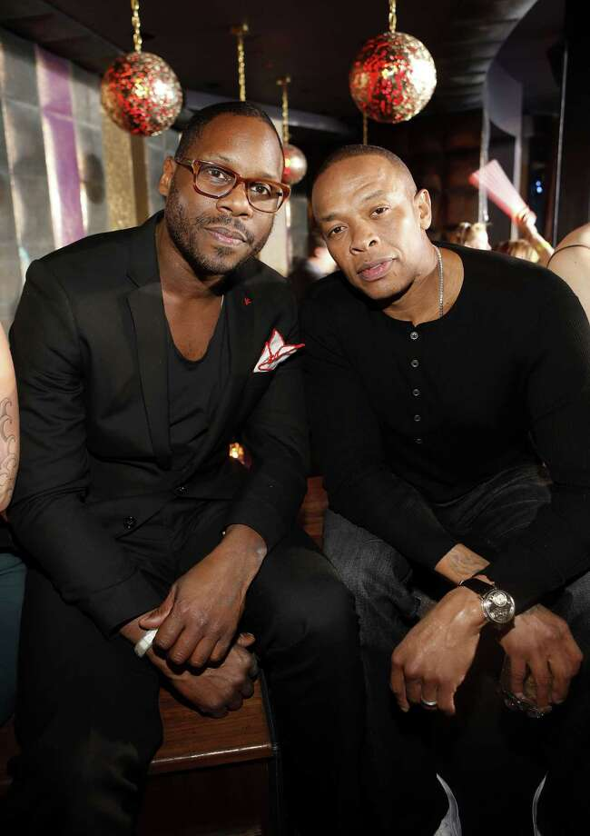 LAS VEGAS, NV - JANUARY 10: Omar Johnson, SVP of Marketing of Beats Electronics LLC, and Dr. Dre, founder of Beats Electronics LLC, enjoy the Beats by Dr. Dre CES after-party at the Marquee Nightclub at The Cosmopolitan of Las Vegas on January 10, 2013 in Las Vegas, Nevada. Photo: Isaac Brekken, Getty Images For Beats By Dre / 2013 Getty Images