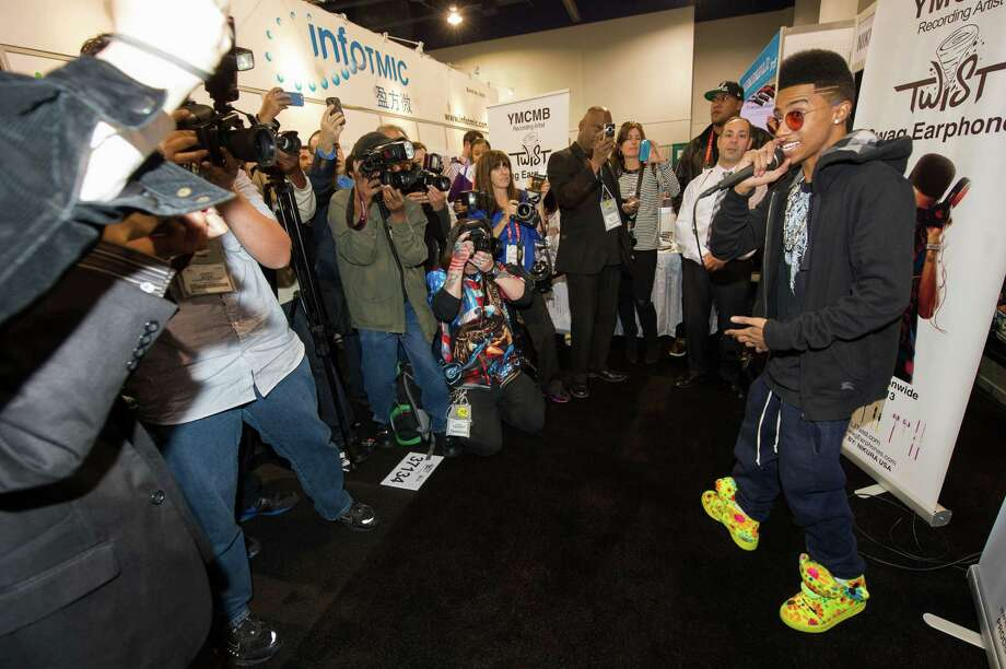 """IMAGE DISTRIBUTED FOR NIKURA USA - Hip hop artist, """"Lil Twist"""" seen at the International CES 2013, on Thursday, Jan. 10, 2013 in Las Vegas, NV for the debut of his new headphone collection """"Twist Swag Headphones by Nikura USA. (Photo by Al Powers of Powers Imagery/Invision for Nikura USA/AP Images) Photo: Powers Imagery, Associated Press / Invision"""