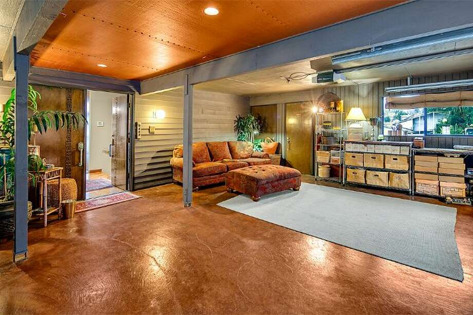Room of 9860 Rainier Ave. S. The 2,601-square-foot house, built in 1971, has four bedrooms, two bathrooms, exposed wood beams, a covered, dock-level entertaining area, a sauna, decks, views and a two-car garage on a 1,213-square-foot lot with 50 feet of frontage along Lake Washington. It's listed for $650,000. Photo: Courtesy Bryan Loveless And Richard Eastern/Windermere Real Estate