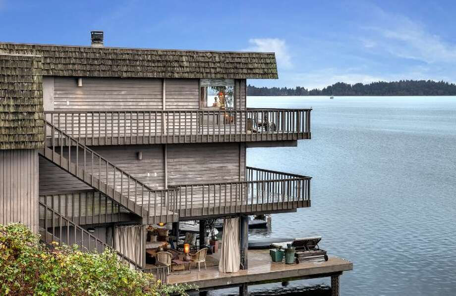 Here's your chance to buy, or at least oogle, a unique house built out over Lake Washington, 9860 Rainier Ave. S. The 2,601-square-foot house, built in 1971, has four bedrooms, two bathrooms, exposed wood beams, a covered, dock-level entertaining area, a sauna, decks, views and a two-car garage on a 1,213-square-foot lot with 50 feet of frontage along Lake Washington. It's listed for $650,000. Photo: Courtesy Bryan Loveless And Richard Eastern/Windermere Real Estate