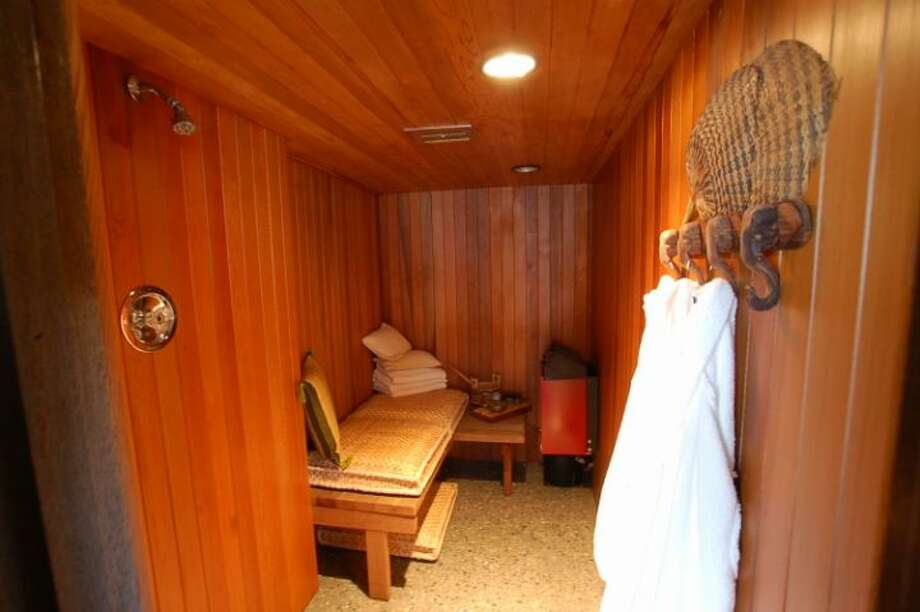 Sauna of 9860 Rainier Ave. S. The 2,601-square-foot house, built in 1971, has four bedrooms, two bathrooms, exposed wood beams, a covered, dock-level entertaining area, decks, views and a two-car garage on a 1,213-square-foot lot with 50 feet of frontage along Lake Washington. It's listed for $650,000. Photo: Courtesy Bryan Loveless And Richard Eastern/Windermere Real Estate