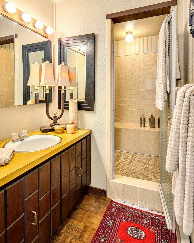 Bathroom of 9860 Rainier Ave. S. The 2,601-square-foot house, built in 1971, has four bedrooms, two bathrooms, exposed wood beams, a covered, dock-level entertaining area, a sauna, decks, views and a two-car garage on a 1,213-square-foot lot with 50 feet of frontage along Lake Washington. It's listed for $650,000. Photo: Courtesy Bryan Loveless And Richard Eastern/Windermere Real Estate
