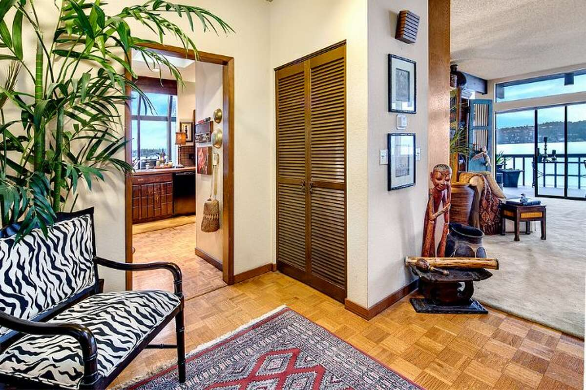 Interior of 9860 Rainier Ave. S. The 2,601-square-foot house, built in 1971, has four bedrooms, two bathrooms, exposed wood beams, a covered, dock-level entertaining area, a sauna, decks, views and a two-car garage on a 1,213-square-foot lot with 50 feet of frontage along Lake Washington. It's listed for $650,000.