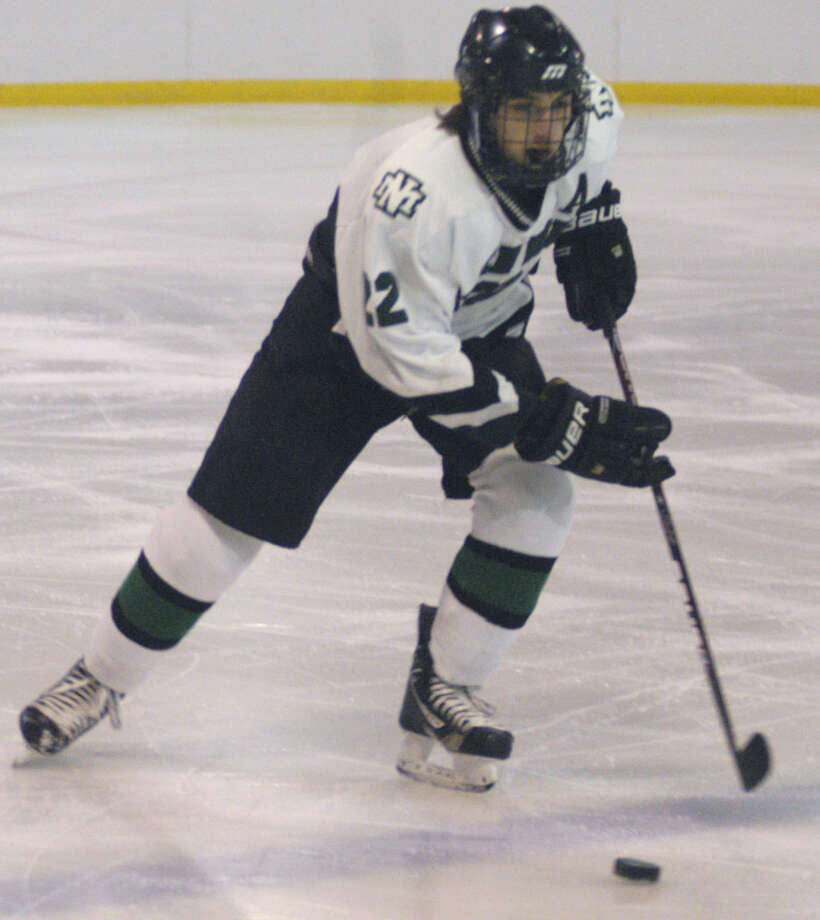 Lorenzo Stellato of the Green Wave glides up the ice during New Milford High School ice hockey's 7-0 victory over Shepaug Valley/Litchfield/Nonnewaug at South Kent School, Jan. 4, 2013 Photo: Norm Cummings