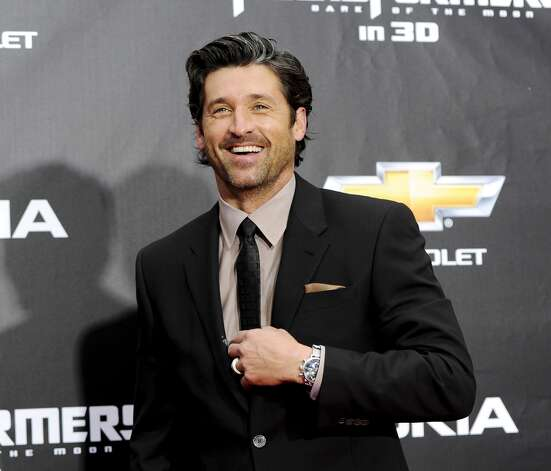"Did handsome Patrick Dempsey use his star wattage to ""unfairly charm"" the Tully's auctioneers? That's what Starbucks says, according to the WSJ. Photo: Associated Press"