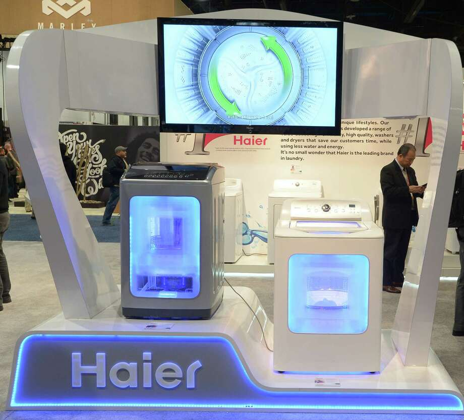 Moder appliences are on display at the HAIER booth. Photo: JOE KLAMAR, AFP/Getty Images / AFP