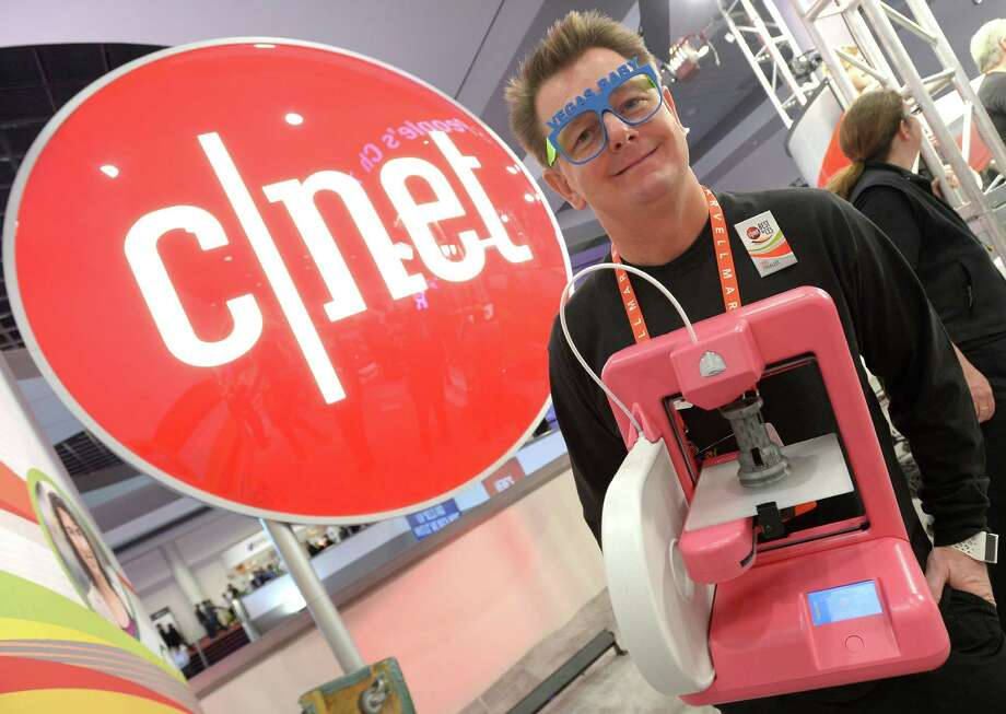 Scott Turner of 3-D Systems Corp. and his 3-D printer wait to participate in C/NET's show. Photo: JOE KLAMAR, AFP/Getty Images / AFP