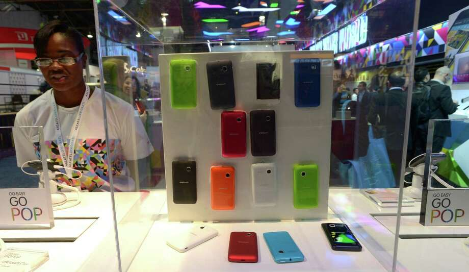 Alcatel's  smartphone accessories are on display Thursday. Photo: JOE KLAMAR, AFP/Getty Images / AFP