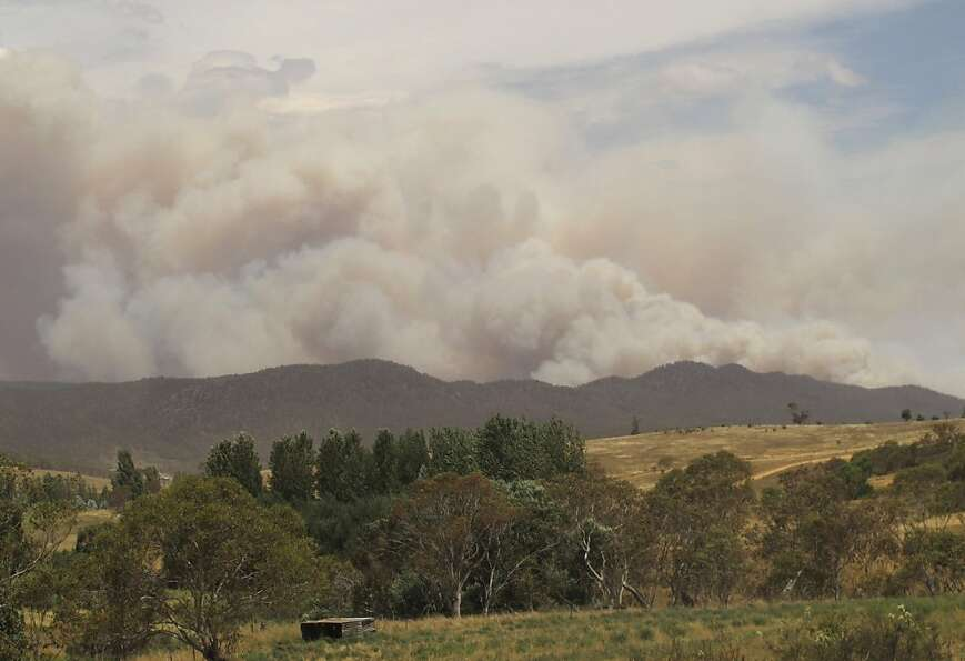 Smoke rises from the hills near the village of Numeralla in New South Wales.
