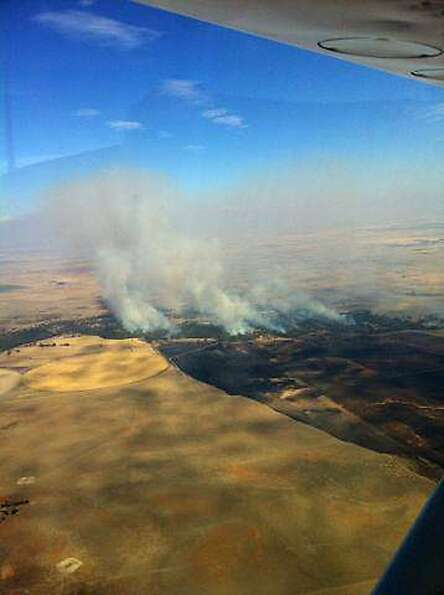 Smoke billows from a fire near Deniliquin, Australia.
