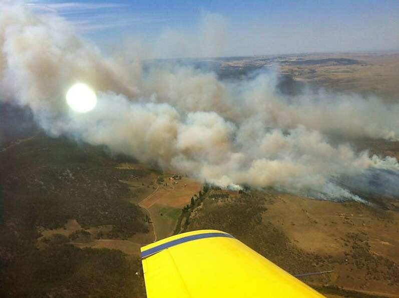Plumes of smoke rise from a fire near Cooma, Australia.