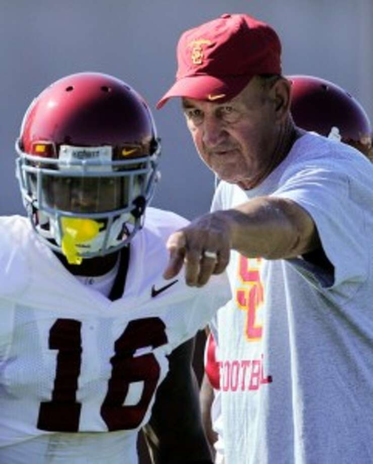 Former USC assistant head coach Monte Kiffin has been hired by the Dallas Cowboys as their new defensive coordinator.  (AP Photo/Mark J. Terrill)
