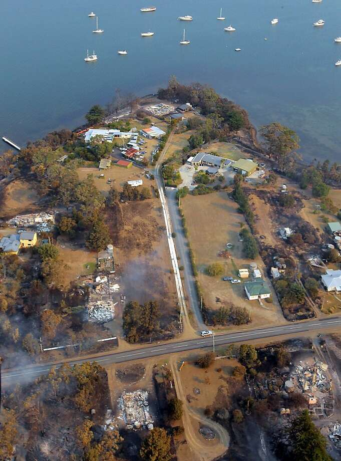 A wildfire destroyed around 80 buildings in and around the small town of Dunalley. Photo: Chris Kidd, Associated Press
