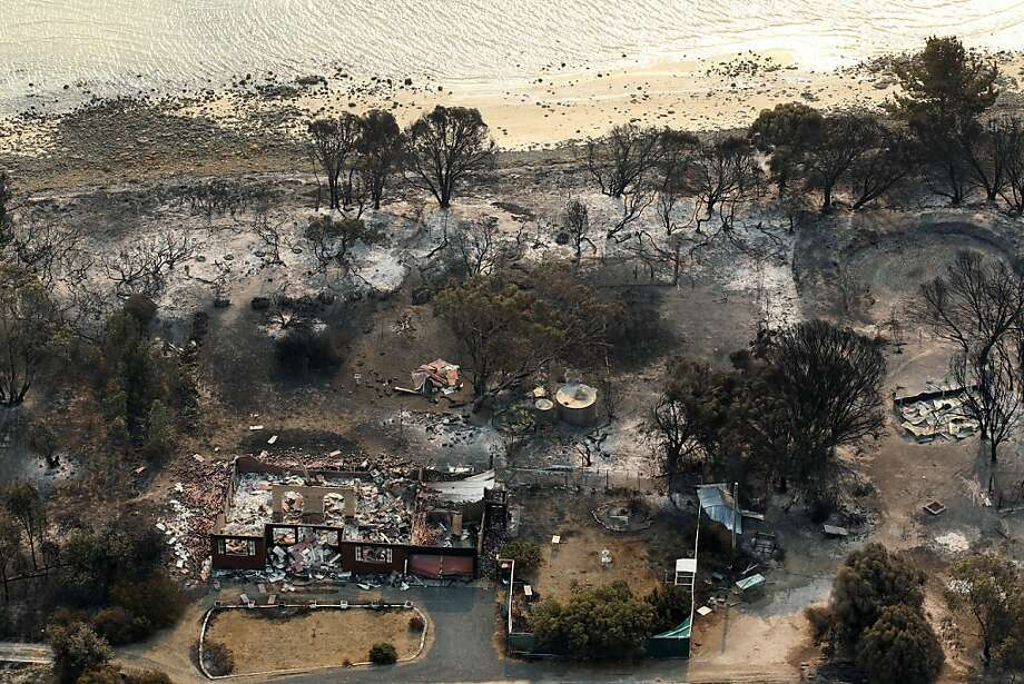 The charred remains of homes after a wildfire swept through near Boomer Bay, in southern Australia, on Saturday, Jan. 5, 2013.  Photo: Chris Kidd, Associated Press
