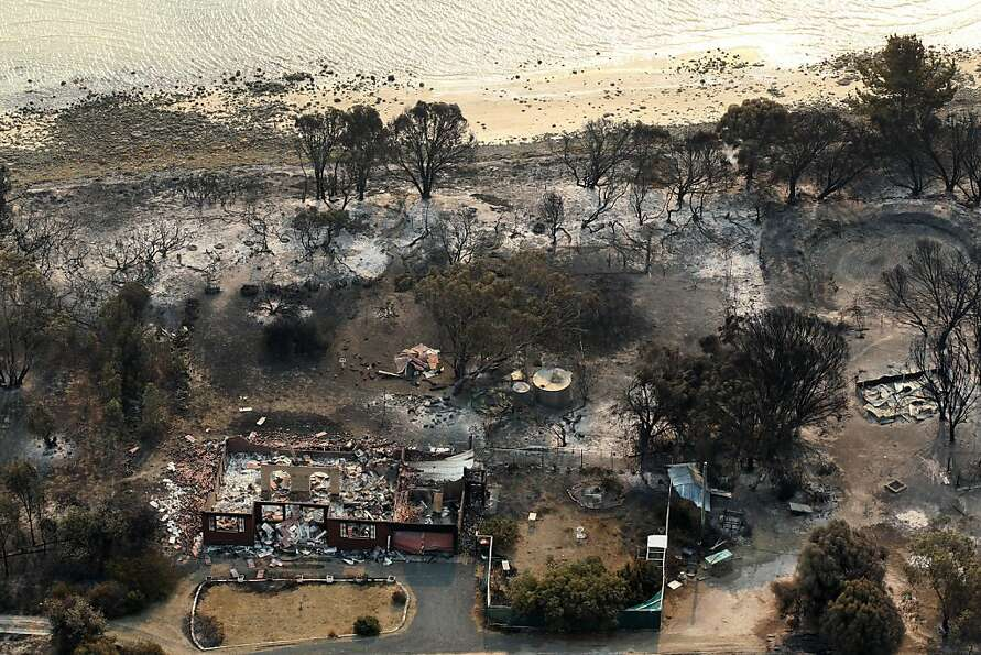 The charred remains of homes after a wildfire swept through near Boomer Bay, in southern Australi